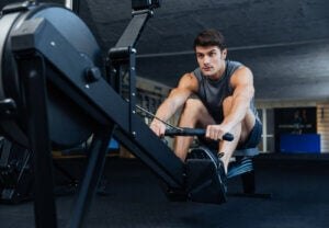 Man trains on rowing machine