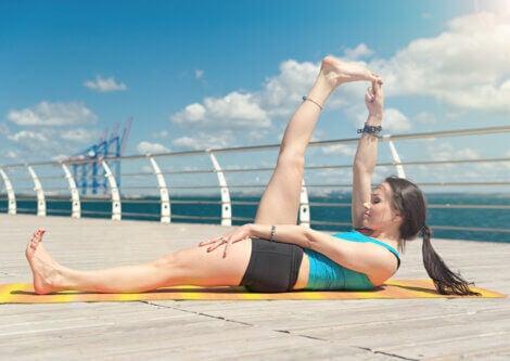 A woman doing leg lift stretches