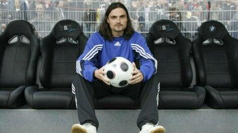 Lutz Pfannenstiel holding a football.