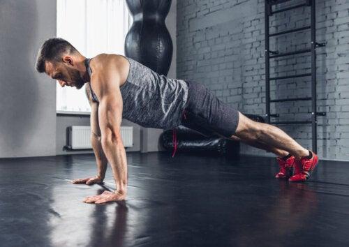 A man doing a push-up.