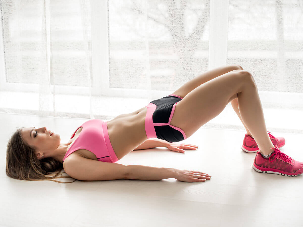 Woman works glutes and hips