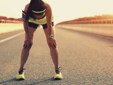 A woman suffering from muscle fatigue after running