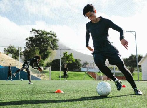 A soccer player kicking a ball.