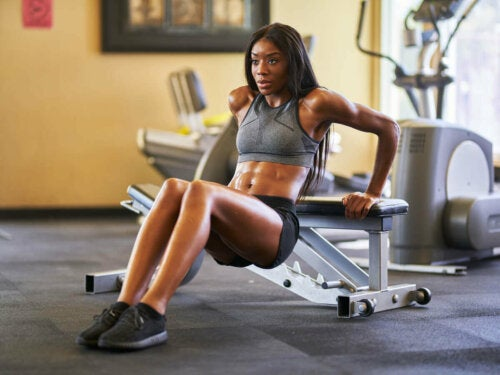 A woman doing dips.