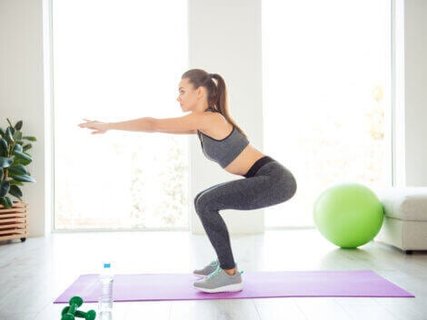 A woman doing squats at home