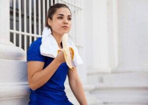 An athlete eating a banana.