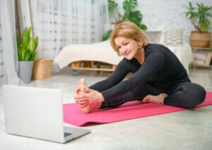 An older woman stretching at home.