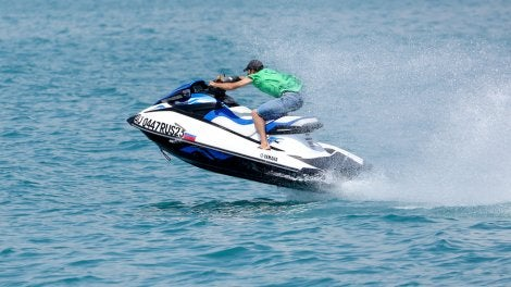 A man racing on a jet ski