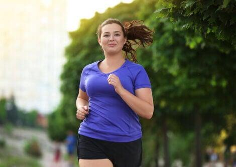 An overweight woman running