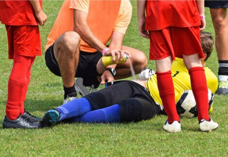 An athlete being treated on the field for hip pain