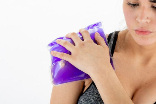 A woman with an ice pack on her shoulder.