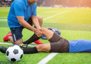 A trainer helping heal an injury.