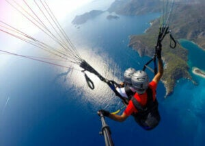 Two people paragliding.