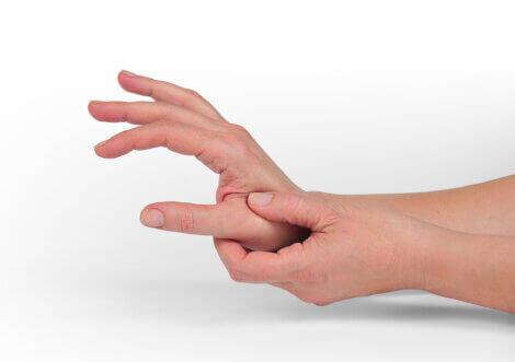 A person rubbing their hand.