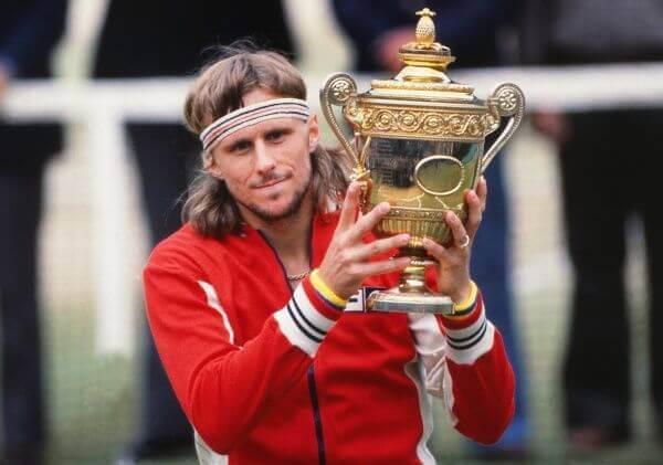Bjorn Borji holding a tennis trophy.