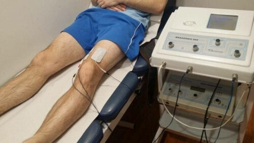 A man getting treated with electroanalgesia.