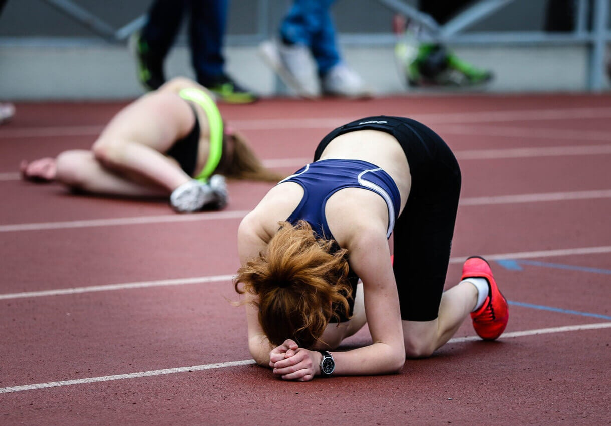 A woman feels bad after losing a race.