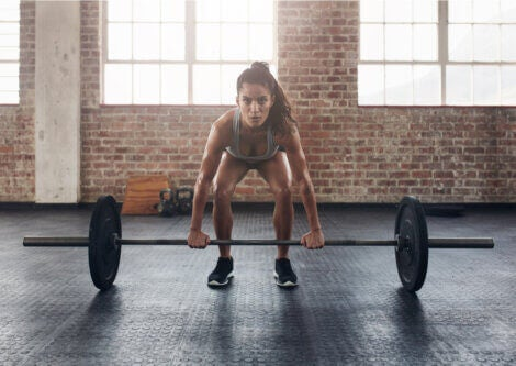 A woman lifting weights.