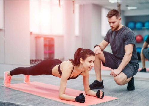A woman exercising with her personal trainer.