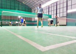 A badminton team on the court.