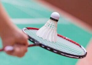 A birdie hitting the racket in badminton.