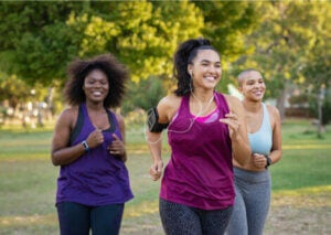 A group of women running in the park.