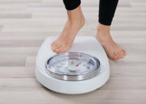 A person stepping on a scale.