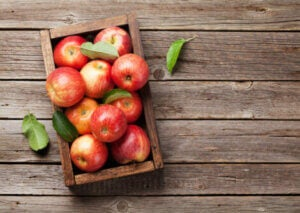 Red apples in a crate.