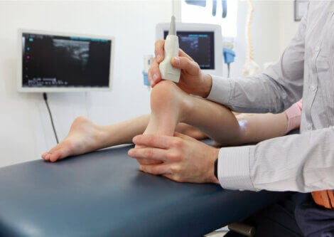 A doctor treating Achilles tendonitis.