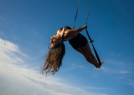 A girl doing an aerial fish pose.
