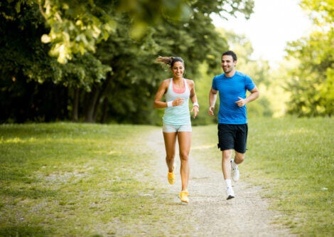 A couple running in a park.