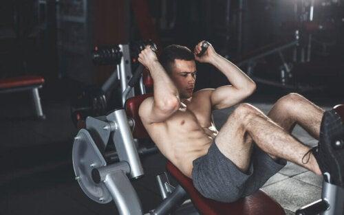 A man doing a hack squat.