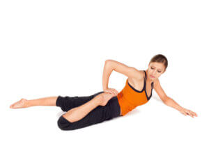 Woman stretches quadriceps
