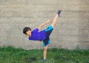 A child practicing taekwondo.