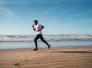 A man running on the beach.