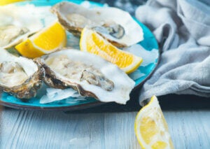 A plate of oysters and lemons.
