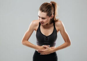 A woman suffering from indigestion.