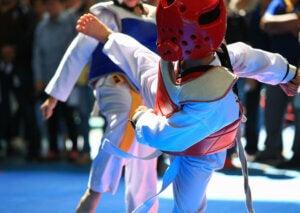 Children competing in taekwondo.