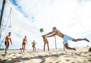 People playing beach volleyball.