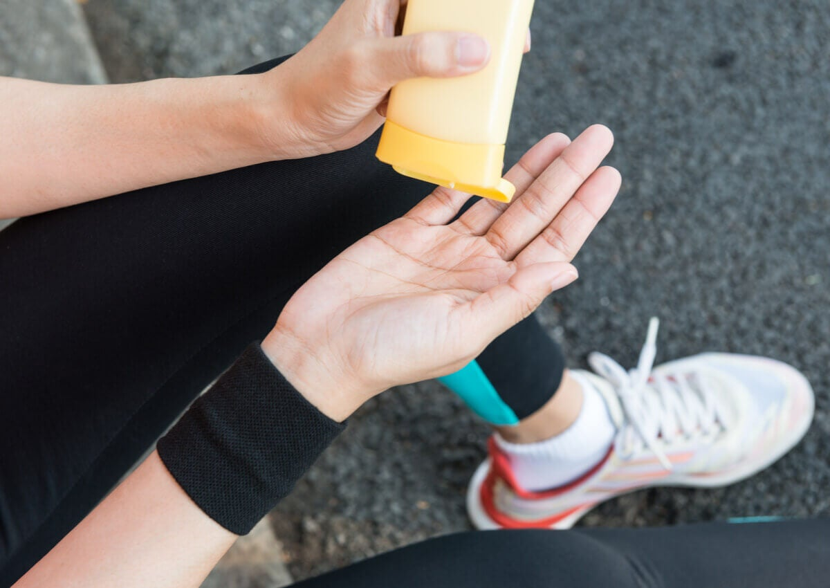 A person exercising and applying a cream.