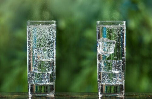 Two tall glasses of sparkling water.