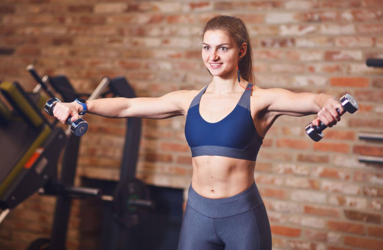 A woman lifting dumbbells.