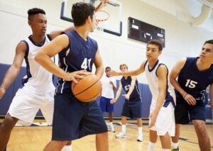 A group of basketball players in a game.