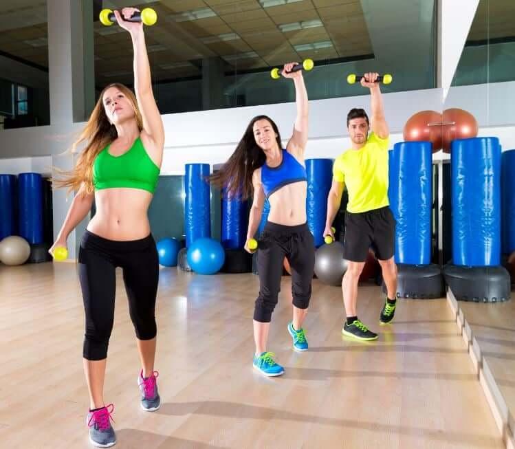 Women and men in a body pump class.