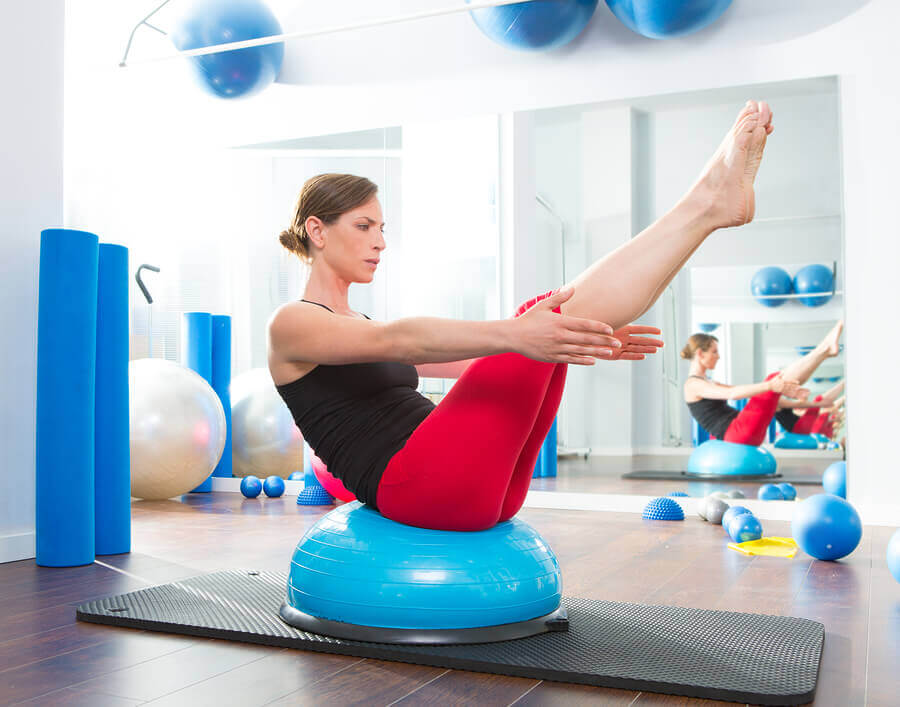A woman doing the hundred on a BOSU ball.
