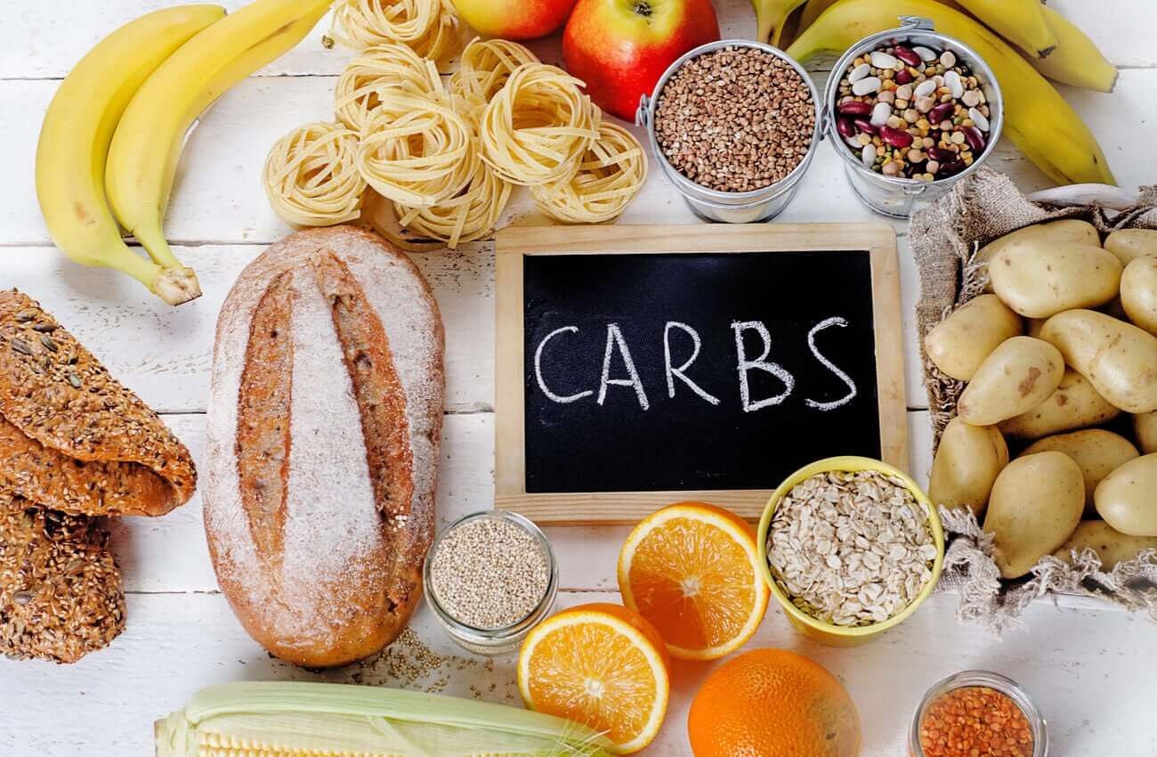 A variety of carbohydrate sources, including bread, pasta, fruit, and seeds.