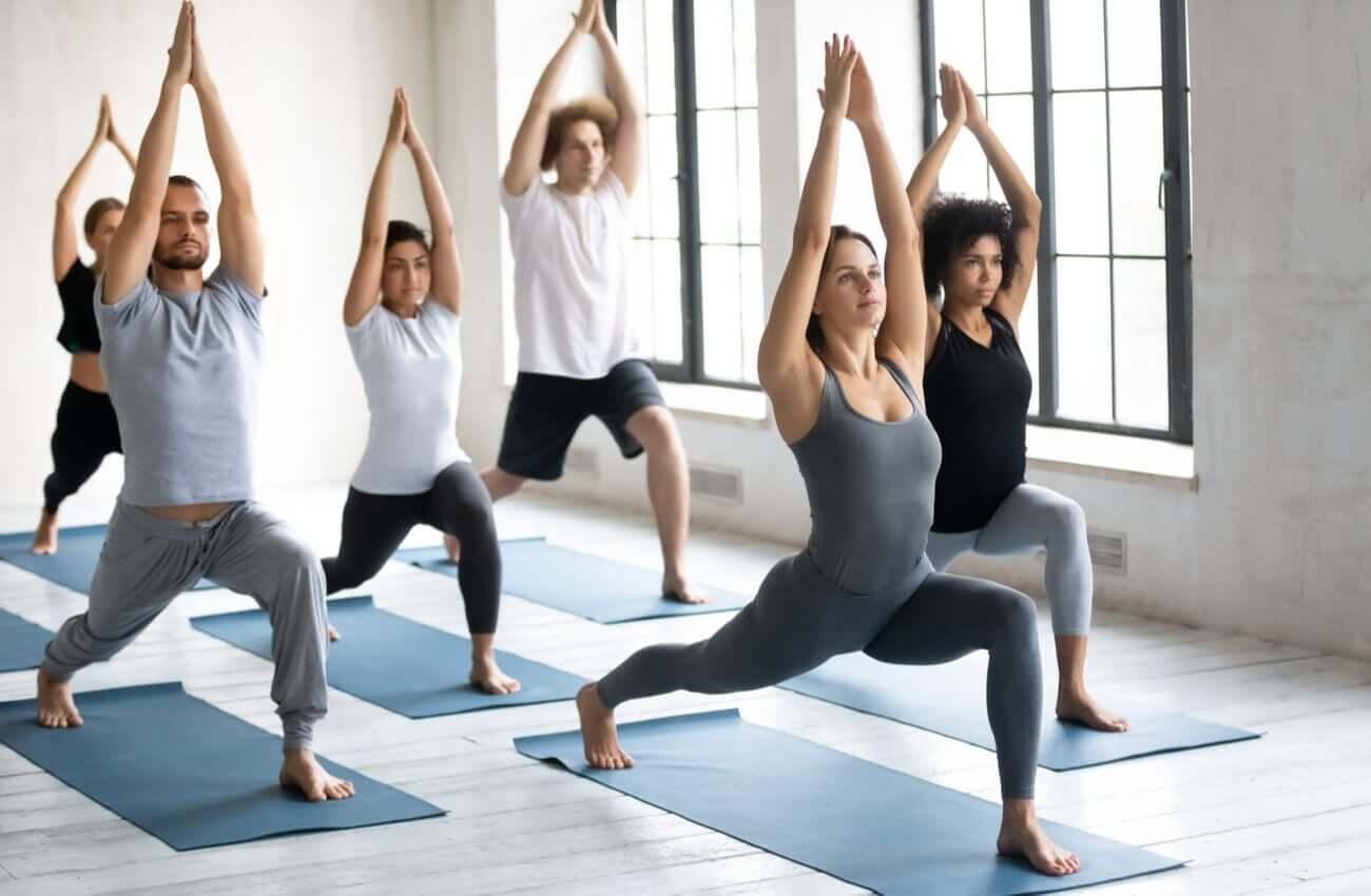 Men and women in a yoga class.