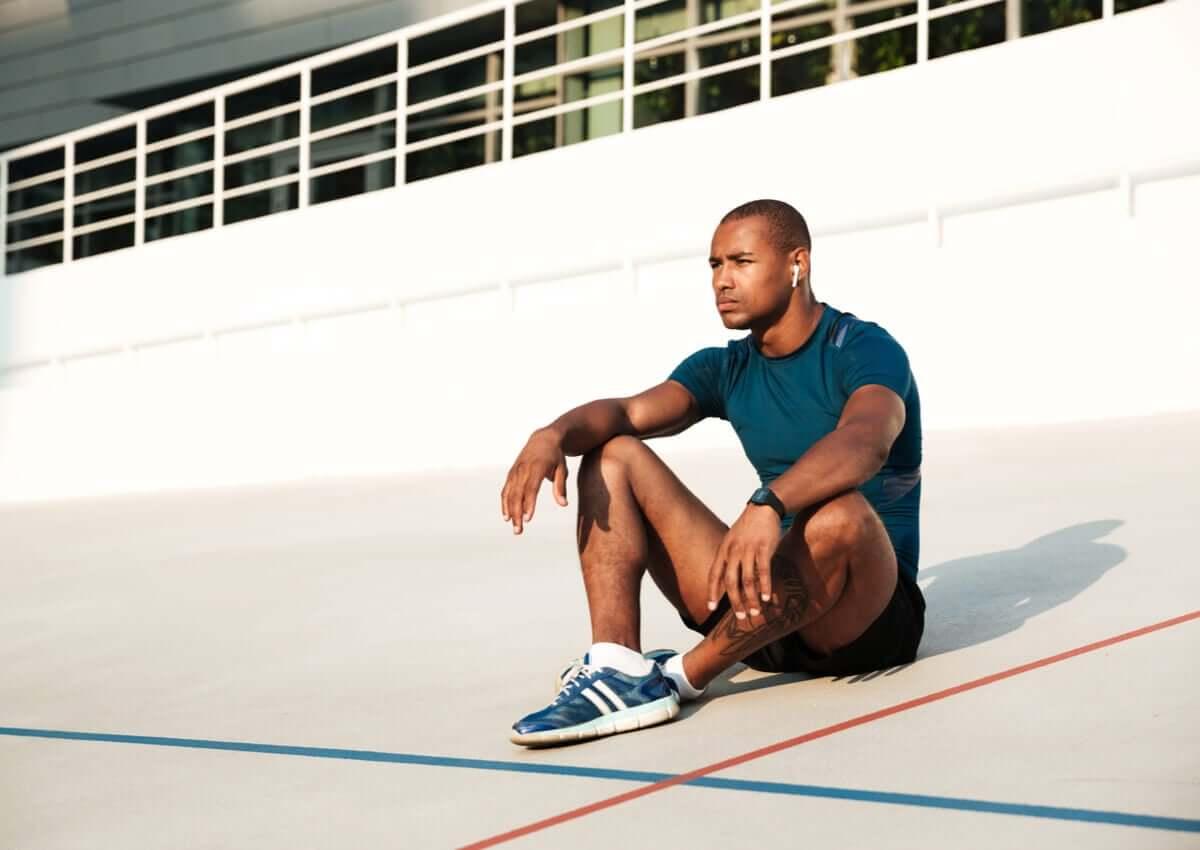 An athlete thinking.