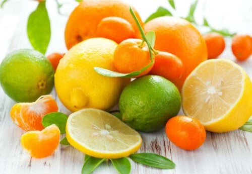 citrus fruits on a table; oranges, limes, lemons