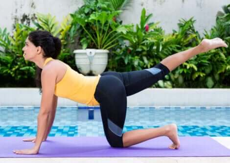 A woman doing hip extension exercises to strengthen her glutes.